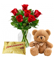 send 6 red roses with yellow bear and toblerone to davao
