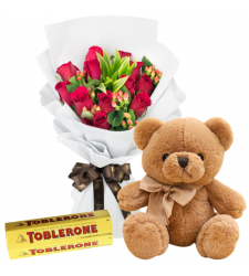 send 12 red roses with teddy and toblerone to davao