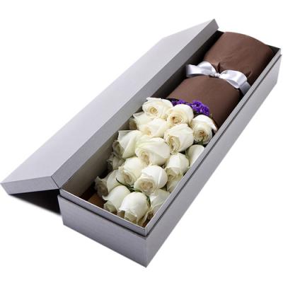 send 2 dozen white color roses in box to davao